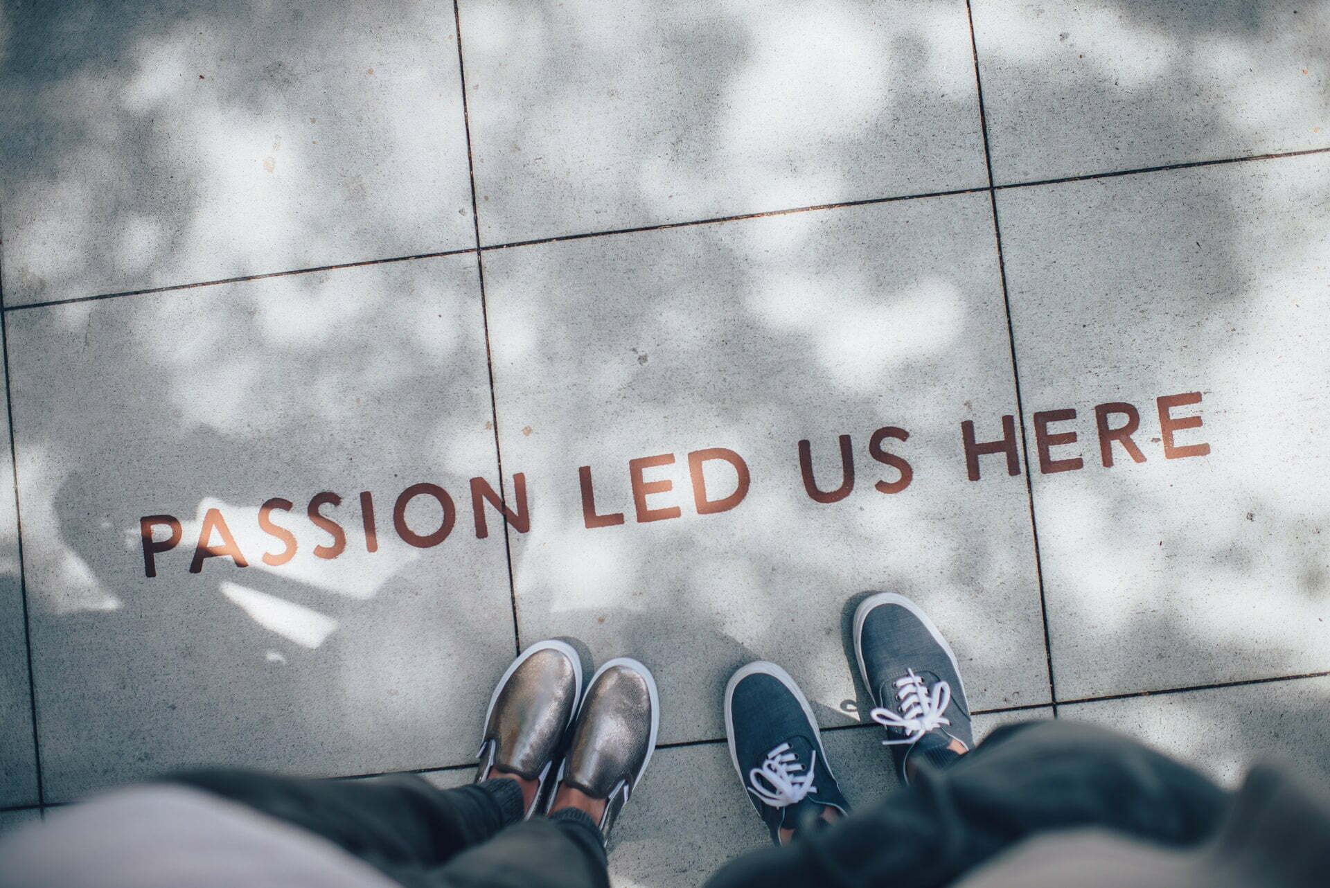 passion led us here written on the sidewalk