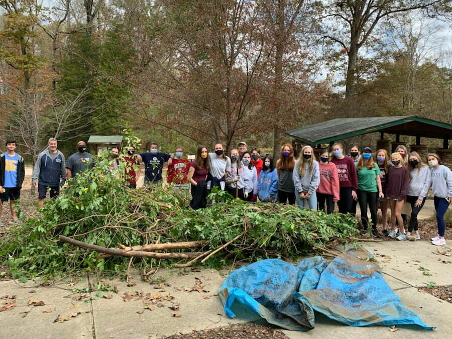 Eran Weaver, other Kiwanians, and approximately 35 Key Club Members removed wisteria vines and cleaned up Squirrel Lake Park in Matthews, North Carolina.