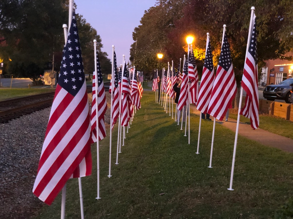 flags for heroes along in downtown Waxhaw NC